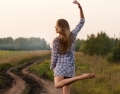 young-girl-dancing-happy-in-a-field-1386580-m copy
